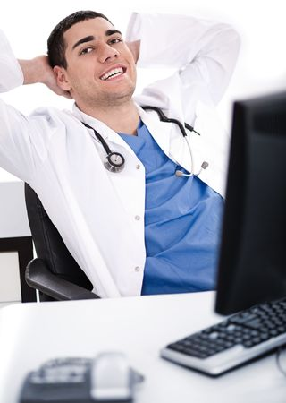 young male doctor: Smiling young male doctor over white background Stock Photo