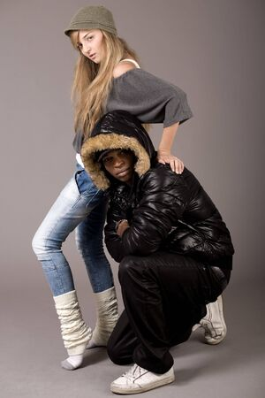 Cute still of a black man and caucasian women on grey background photo