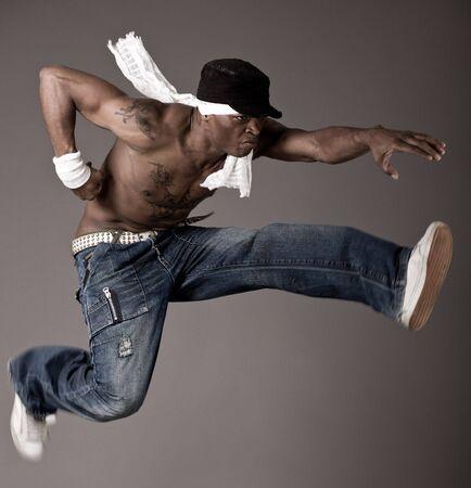 Afro-american make jumping dance photo