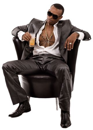 drug dealer: Attractive young business man having a glass of juice in his hand on a light background
