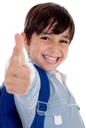 Smiling kinder garden boy gives thumbs up on isolated white background 스톡 콘텐츠