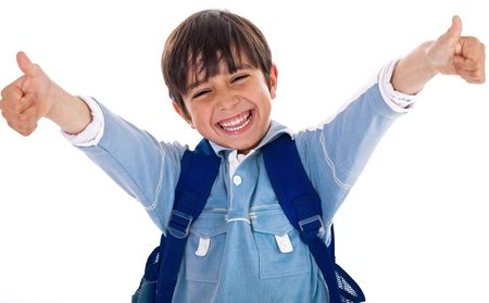 Cheerful school boy showing his thumbs up on isolated white background photo
