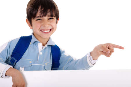 copy sapce: Happy young boy pointing to copy sapce on isolated white background