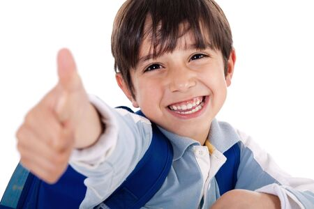 Cute boy showing ok sign on white background photo
