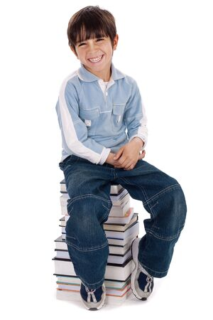 Smiling young kid sitting over pile of books on isolated white background Stock Photo - 6494704
