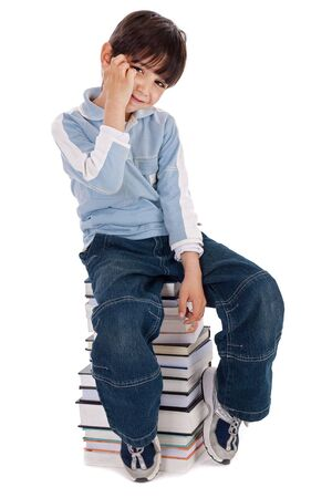 Young boy sitting over tower of books on white background Stock Photo - 6494709