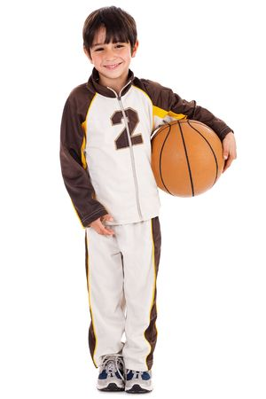 Adorable young kid in his sports dress with ball on isolated white background Foto de archivo