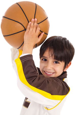Little kid while throwing the ball on white isolated background photo