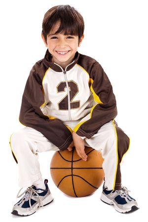 Kid stylishly sitting on the ball, isolated background photo