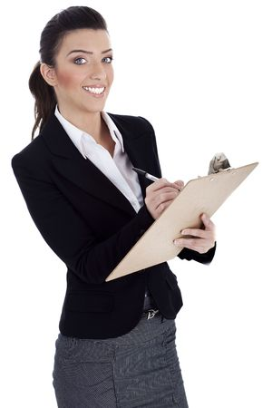 Business professional writes on pad over isolated background photo