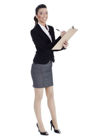 Full length of business woman writing in pad over white background photo