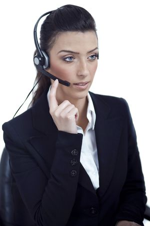 customercare: Beautiful call center telephone woman wearing headset over white background Stock Photo