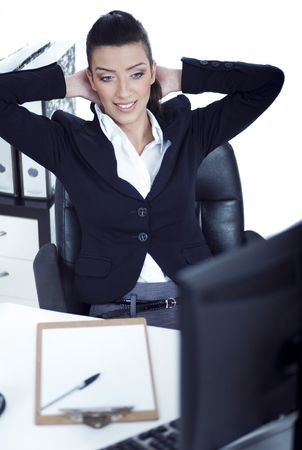 Relaxing business woman at her bay over white background photo
