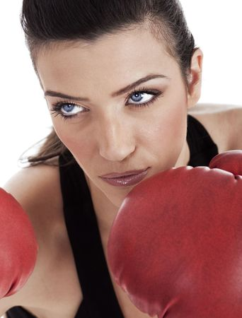 Aggressive boxing woman over white background photo