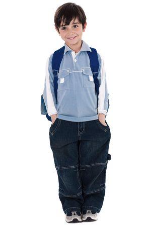 ni�o parado: chico joven escuela permanente en fondo blanco de aislados  Foto de archivo