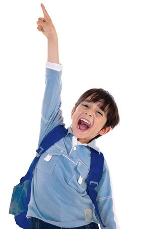 Young school boy excitingly shouts and raise his hand up on isolated white background