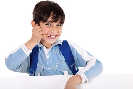Smiling young boy acts as he talks over phone on isolated white background Stock Photo - 6752366