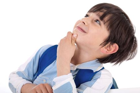 Cute kid thinking and looking up on isolated white background photo