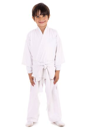 Karate kid in uniform on white isolated background photo