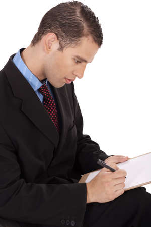 Closeup of a business man writing down with notepad on a white background Stock Photo - 6955773