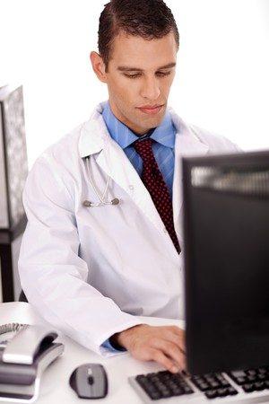 proffesional: young physician working on his office over a white background.