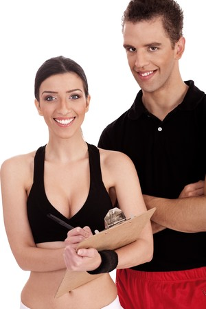 Fitness trainers folded their hands over white background photo