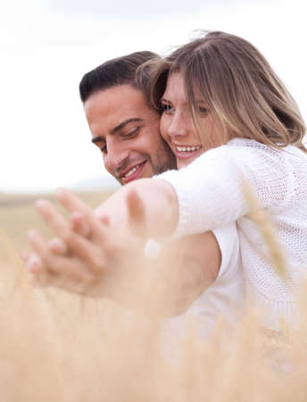 lovely couple, woman holding hands round the neck of her boyfriend photo