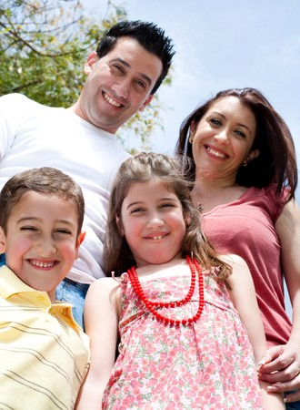 Beautifull shot of a happy family in the park,outdoor Stock Photo - 6956475