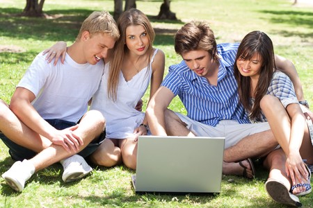 Young boys and girl students using laptop in the campus Stock Photo - 6956651