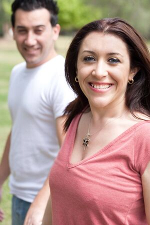Happy woman with her husband in the park photo