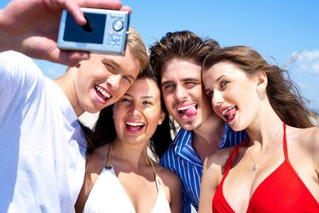 Group of young friends standing together taking a self portrait  photo