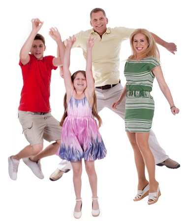 Cheerful family jumping to the air and having fun  over white background