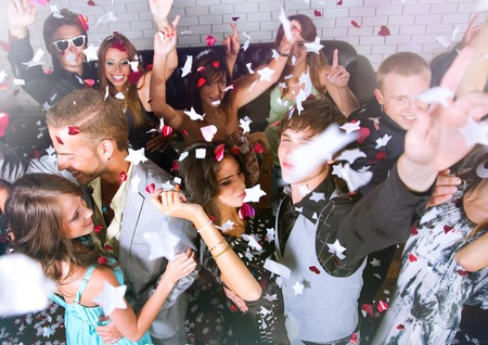 friends party: Top view of a group of people dancing in a bar or nightclub at a party