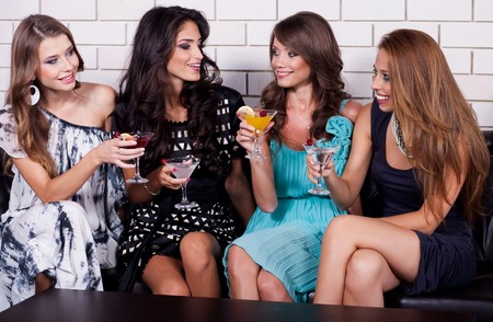 night club: Group of woman at cocktail party have fun Stock Photo