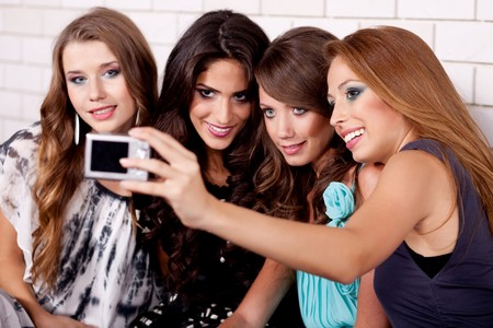 Closeup of a happy young group taking self portrait photo