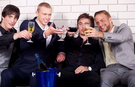people partying: Group of friends have fun and drink at night club