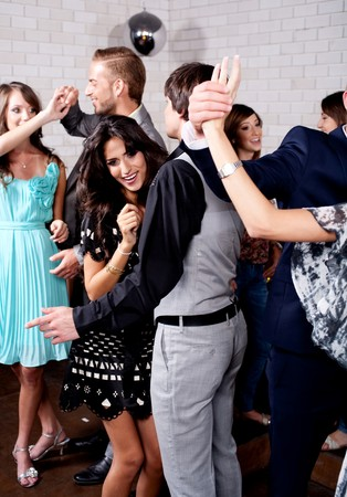 Group of many people dance at night club Stock Photo