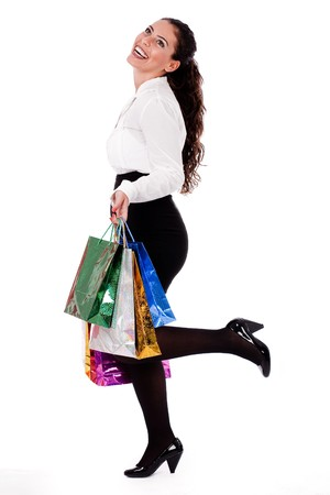 Full length shot of young woman holding shopping bag on white isolated background Stock Photo - 7261624