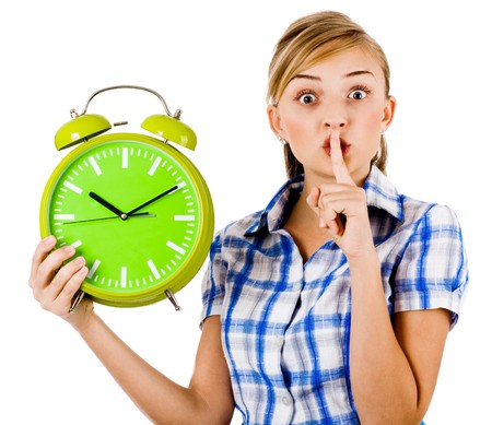 Girl with the clock asking us to maintain silence on a white background photo