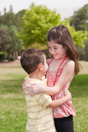 Brother and sister affectionatly hugging in the park, outdoor Stock Photo - 7420986