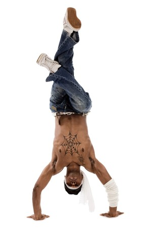 freezed: Hip hop dancer freezed his movements on isolated white background