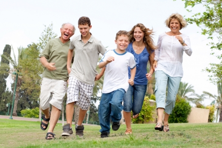 grandfather and grandmother: Happy family. Grandfather, grandmother, and brothers enjoying outdoors and having fun