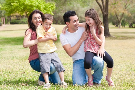 family park: Close up of a Happy family enjoying in a park with their children Stock Photo