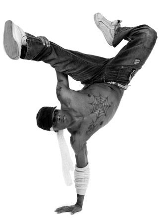 Hip hop dancer freezed his movements on isolated white background