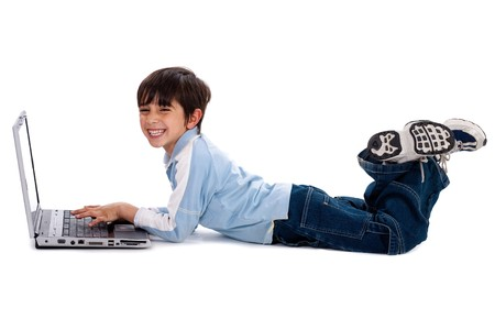 laying on back: Young boy lying on floor and surfing on his laptop