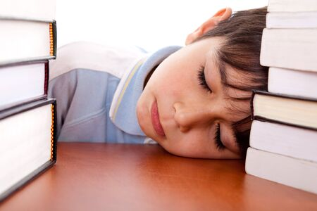 pileup: School boy tired of studying and sleeping on table
