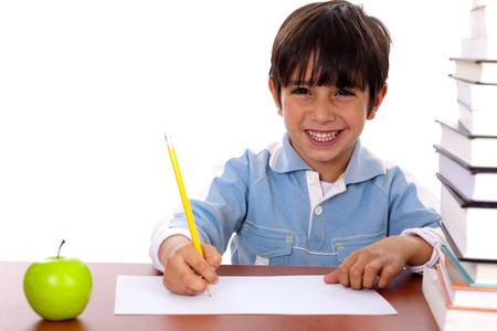 Young kid enjoying art as he draws on blank sheet of paper Stock Photo - 7462883