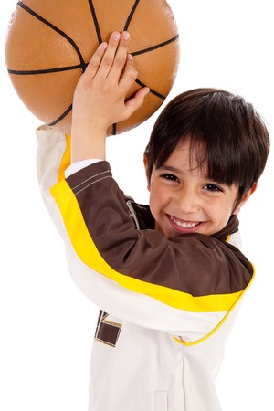 Little kid while throwing the ball while playing the basket ball  on white isolated background,closeup shot photo