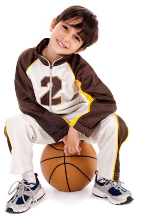 Cute kid stylishly sitting on the ball, isolated background