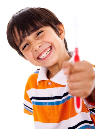 Happy young boy showing the toothbrush on isoalted background Banque d'images